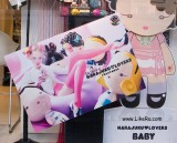 Latex kids clothes in street ads