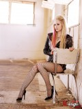 Avril Lavingne in … of course … fishnets … and … high heels.