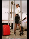stella-21 Fetish office style: latex suit, high heels and seamed pantyhose