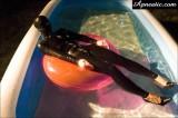 apnea-47 in latex catsuit, latex hood and high heels swimming in the pool