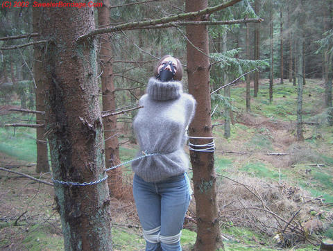 image Slave tied to tree and slapped