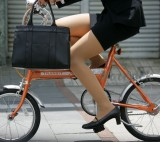 Girl in pantyhose andminiskirt on a bicycle - ph-bike-02