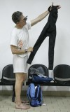 Reuters correspondent Ian Simpson holds a Jaked 01 full body all-polyurethane swimsuit prior to testing it at a pool in Rome July 30, 2009.