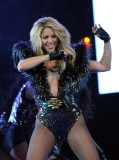 Shakira in shiny pantyhose and bodysuit
