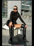 Stella van Gent. Thigh high boots and shiny pantyhose
