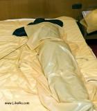 self-bondage hogtie session latex bed