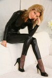 shiny lycra wetlook catsuit and high heels