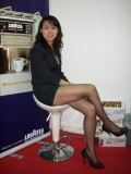 office girl in miniskirt black pantyhose and high-heels