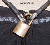 The padlock is threaded through the biggest hole at the base of the slider.