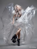 Lady Gaga in a custom-made Armani Privé transparent PVC dress, corset, and boots.