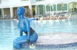 Bianca encased in semitransparent blue latex, fountains and clothing styles