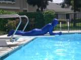 Swimming in shiny blue zentai. Part II