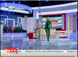 Zlata in a green shiny catsuit on TV Romania