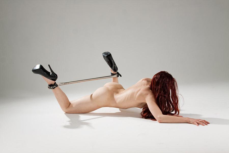 Spreader bar inhibitor bar bondage, naked girl bottom