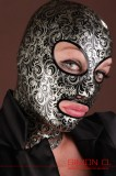 Silver floral print latex hood. Sold for 141,10€